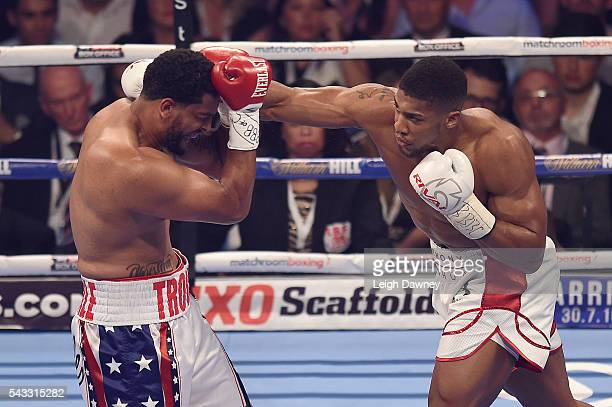 Anthony Joshua throws a right hand punch on Dominic Breazeale during their bout for the IBF World Heavyweight Title at The O2 Arena on June 25 2016...