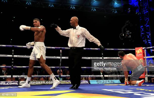 Anthony Joshua walks away after knocking down Wladimir Klitschko in the IBF WBA and IBO Heavyweight World Title bout at Wembley Stadium on April 29...