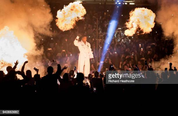 Anthony Joshua walks to the ring prior to his WBA IBF WBO IBO Heavyweight Championship title fight against Joseph Parker at Principality Stadium on...