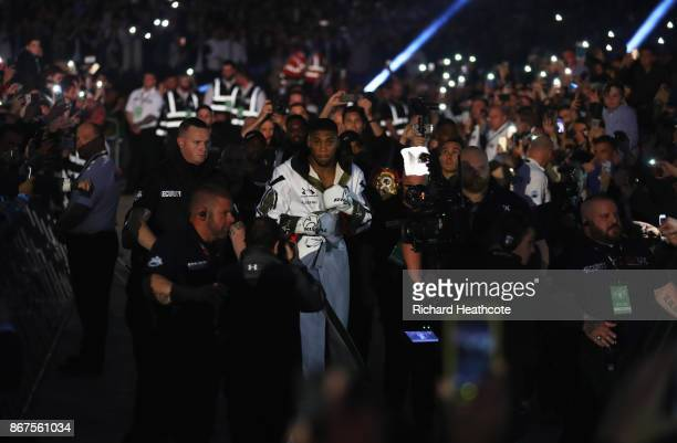 Anthony Joshua walks to the ring prior to the IBF, WBA & IBO Heavyweight Championship contest against Carlos Takam at Principality Stadium on October...