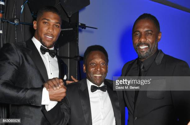 Anthony Joshua winner of the Sportsman of the Year award Pele winner of the Inspiration award and Idris Elba attend the GQ Men Of The Year Awards at...