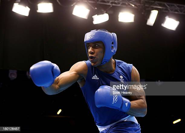 Anthony Joshuaof Great Britain competes against Ivan Dychko of Kazakhstan during their Men's Super Heavy Boxing semifinal bout on Day 14 of the...
