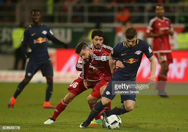 Anthony Jung Almog Cohen of Ingolstadt fights for the ball with Marcel Sabitzer of Leipzig during the Bundesliga match between FC Ingolstadt 04 and...