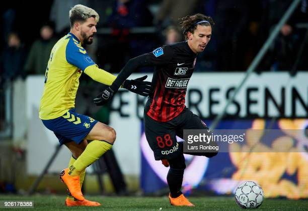 Anthony Jung of Brondby IF and Gustav Wikheim of FC Midtjylland compete for the ball during the Danish Alka Superliga match between FC Midtjylland...