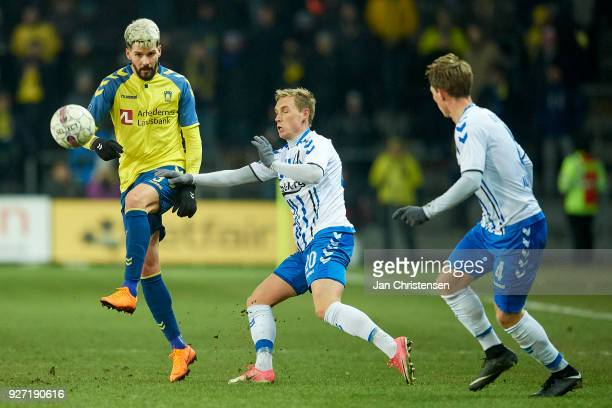Anthony Jung of Brondby IF and Jacob Barrett Laursen of OB Odense compete for the ball during the Danish Alka Superliga match between Brondby IF and...