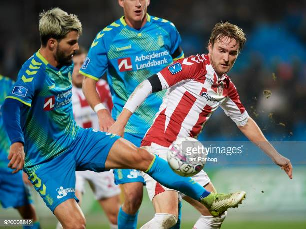 Anthony Jung of Brondby IF and Jannik Pohl of AaB Aalborg compete for the ball during the Danish Alka Superliga match between AaB Aalborg and Brondby...