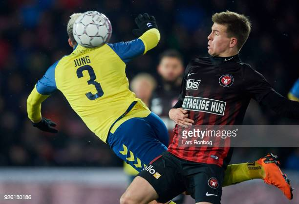 Anthony Jung of Brondby IF and Mads Dohr Thychosen of FC Midtjylland compete for the ball during the Danish Alka Superliga match between FC...