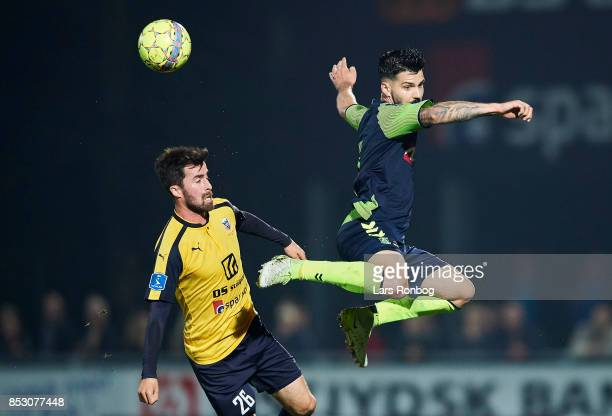 Anthony Jung of Brondby IF and Martin Mikkelsen of Hobro IK compete for the ball during the Danish Alka Superliga match between Hobro IK and Brondby...