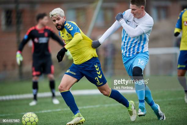 Anthony Jung of Brondby IF and Morten Nielsen of FC Roskilde compete for the ball during the test match Brondby IF vs FC Roskilde at Brondby Stadion...