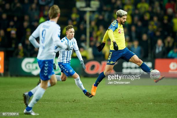 Anthony Jung of Brondby IF compete for the ball during the Danish Alka Superliga match between Brondby IF and OB Odense at Brondby Stadion on March...