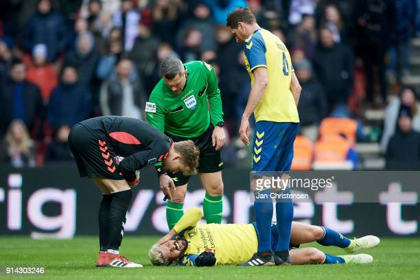 Anthony Jung of Brondby IF get an injury during the Danish Cup DBU Pokalen match between FC Copenhagen and Brondby IF in Telia Parken Stadium on...