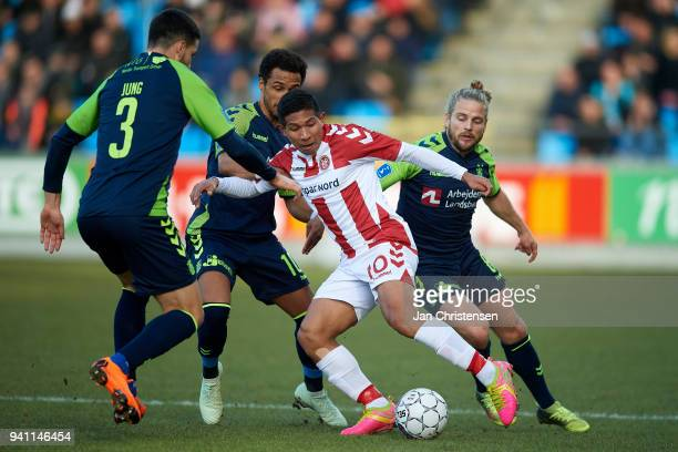 Anthony Jung of Brondby IF Hany Mukhtar of Brondby IF Edison Flores of AaB Aalborg and Kasper Fisker of Brondby IF compete for the ball during the...