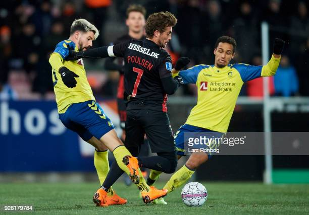 Anthony Jung of Brondby IF Jakob Poulsen of FC Midtjylland and Hany Mukhtar of Brondby IF compete for the ball during the Danish Alka Superliga match...