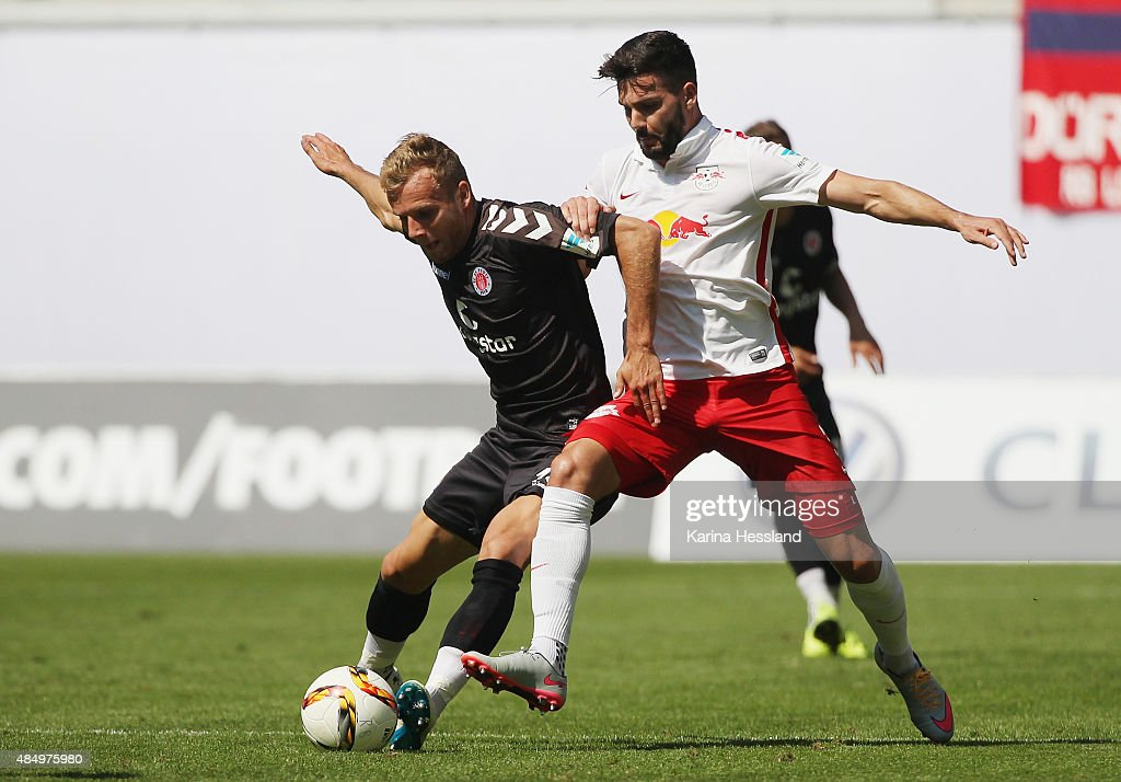 Anthony Jung of Leipzig challenges Lennart Thy of St. Pauli during the Second League match between RB Leipzig and FC St.Pauli at Red-Bull Arena on August 23, 2015 in Leipzig, Germany.