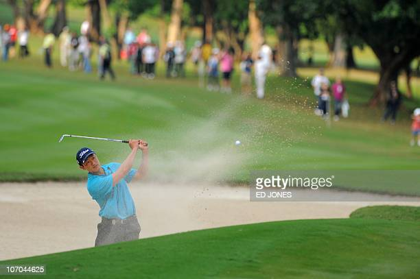 Anthony Kang of the US hits a bunker shot during the final day of the UBS Hong Kong Open golf tournament at the Hong Kong Golf Club on November 21...