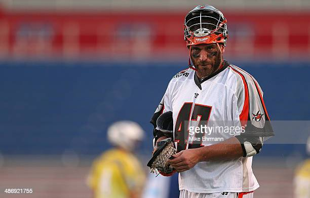 Anthony Kelly of the Denver Outlaws looks on during a game against the Florida Launch at FAU Stadium on April 26 2014 in Boca Raton Florida