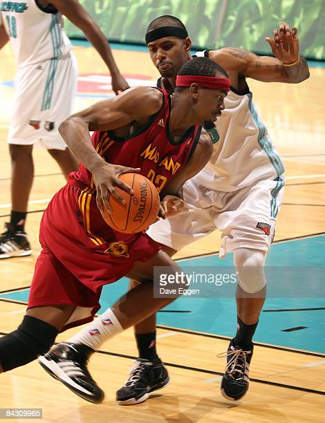 Anthony Kent of the Fort Wayne Mad Ants drives into Gary Ervin of the Sioux Falls Skyforce during their NBA D-League game at the Sioux Falls Arena...