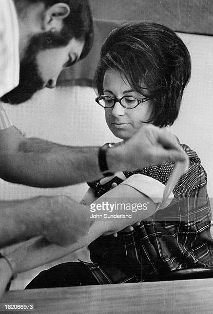JAN 22 1973 Anthony Keyser a chemist at Colorado General Hospital ^ in Denver takes a blood sample from Mrs Fiodell Dubowitz 1250 S Monaco St Parkway...
