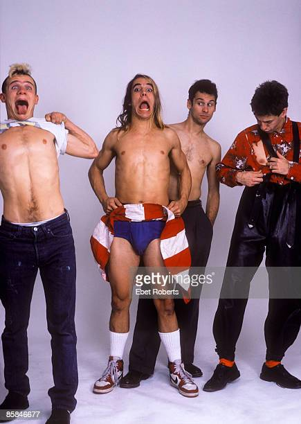 Photo of RED HOT CHILI PEPPERS Anthony KIEDIS and Cliff MARTINEZ and Hillel SLOVAK and FLEA LR Flea Anthony Kiedis Cliff Martinez Hillel Slovak posed...