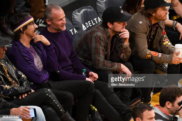 Anthony Kiedis and Flea of Red Hot Chili Peppers and actor Josh Hutcherson attend a basketball game between the Los Angeles Lakers and the New York...