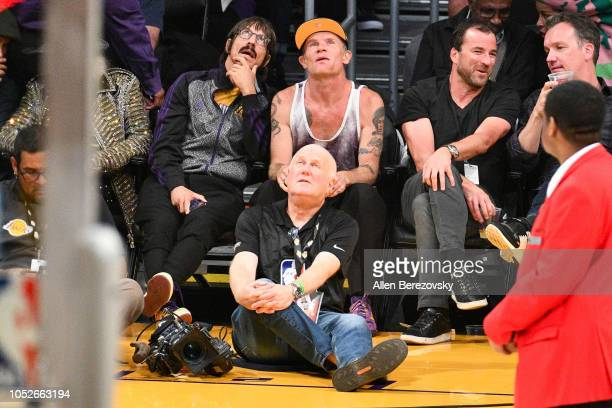 Anthony kiedis and Flea of Red Hot Chili Peppers attend a basketball game between the Los Angeles Lakers and the Houston Rockets at Staples Center on...