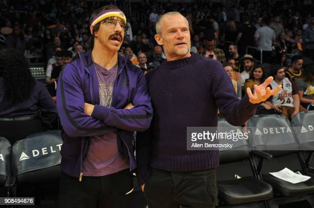 Anthony Kiedis and Flea of Red Hot Chili Peppers attend a basketball game between the Los Angeles Lakers and the New York Knicks at Staples Center on...