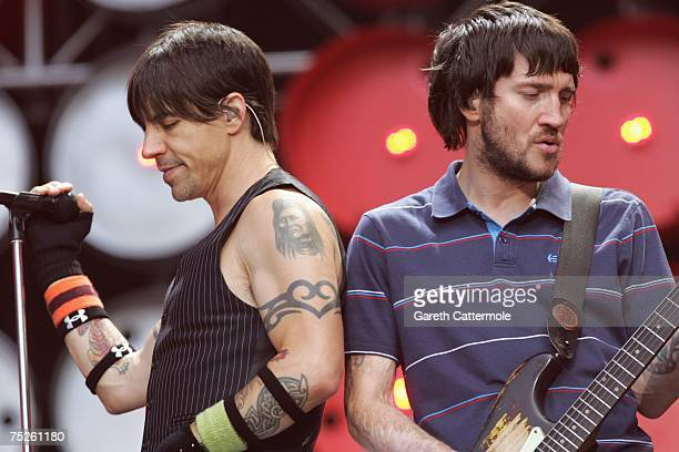 Anthony Kiedis and John Frusciante of the Red Hot Chilli Peppers performs on stage during the Live Earth concert at Wembley Stadium on July 7 2007 in...