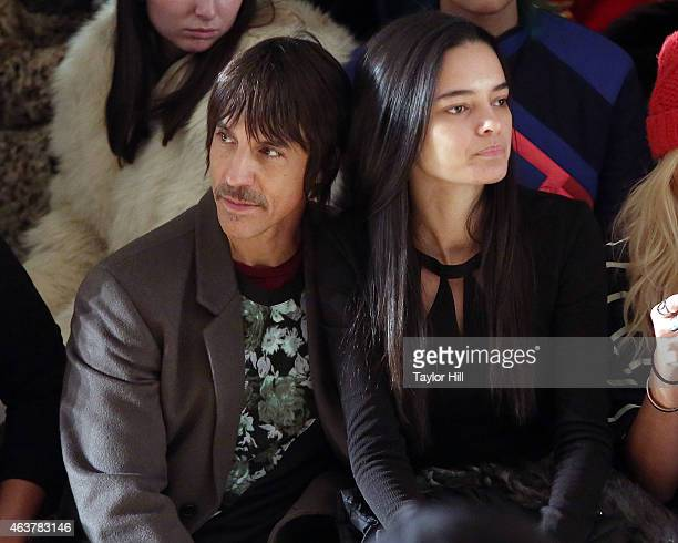 Anthony Kiedis and Wanessa Milhomem watch the Jeremy Scott fall 2015 fashion show at Milk Studios on February 18 2015 in New York City