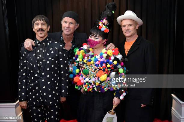 Anthony Kiedis Chad Smith and Flea of Red Hot Chili Peppers with Du Yen attend the 61st Annual GRAMMY Awards at Staples Center on February 10 2019 in...