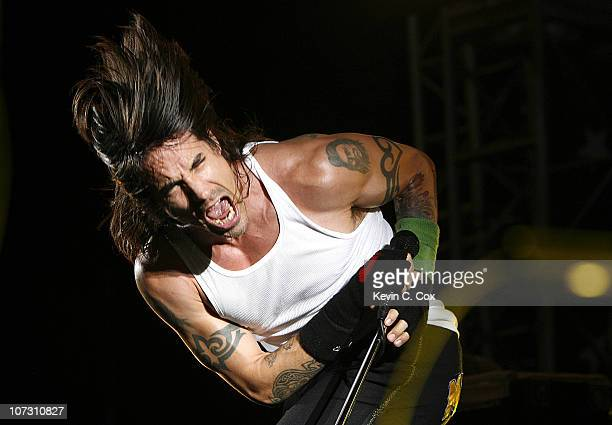 Anthony Kiedis is the lead vocalist of The Red Hot Chili Peppers seen here performing during the Red Hot Pit Stop in the NASCAR NEXTEL Cup AllStar...