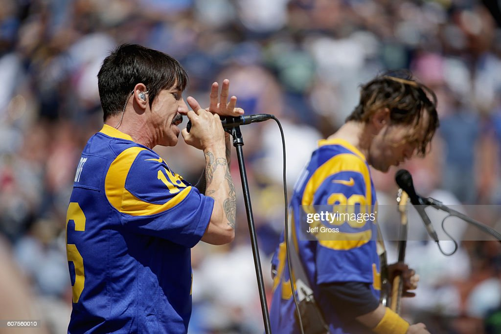 Anthony Kiedis of the Red Hot Chili Peppers performs before the Los Angeles Rams home opening NFL game against the Seattle Seahawks at Los Angeles Coliseum on September 18, 2016 in Los Angeles, California.