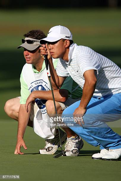 Anthony Kim and caddie Ron Levin analyze the 3rd green during the first round of the 89th PGA Championship at Southern Hills Country Club in Tulsa OK