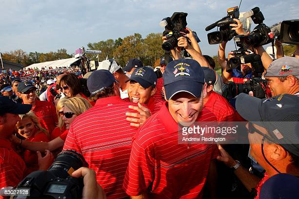 Anthony Kim and Jim Furyk of the USA team celebrate among teammates and media in honor of the USA 16 1/2 11 1/2 victory on the final day of the 2008...