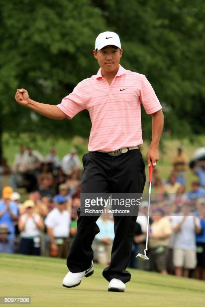 Anthony Kim celebrates as he holes a birdie putt on the 18th green during the third round of the Wachovia Championship at Quail Hollow Country Club...