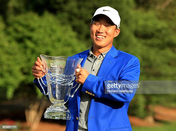 Anthony Kim celebrates victory with the trophy during the final round of the Wachovia Championship at Quail Hollow Country Club on May 4 2008...