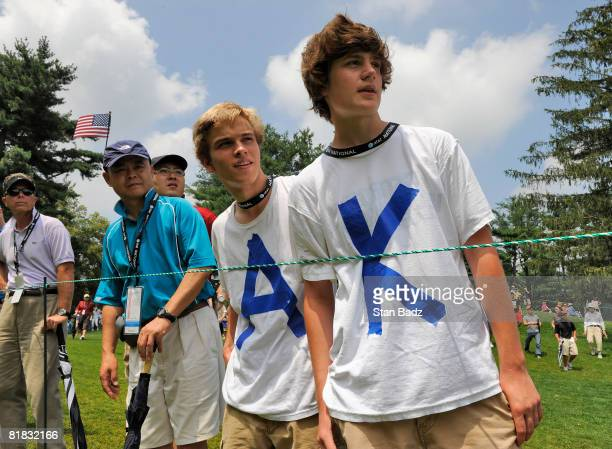 Anthony Kim fans, Matthew Carr, and Conrad Depeuter, watch play at the third tee box during the third round of the AT&T National held on the Blue...