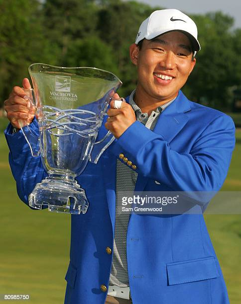 Anthony Kim holds the trophy after his five stroke victory at the Wachovia Championship at Quail Hollow Country Club on May 4 2008 in Charlotte North...