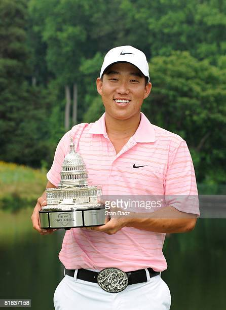 Anthony Kim holds the winner's trophy after the final round of the AT&T National held on the Blue Golf Course at Congressional Country Club on July...