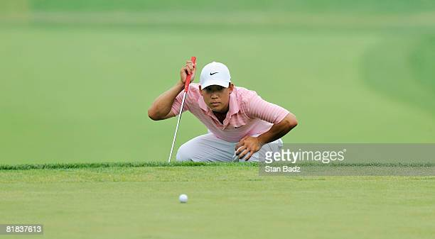 Anthony Kim lines up his putt at the 17th green during the final round of the ATT National held on the Blue Golf Course at Congressional Country Club...