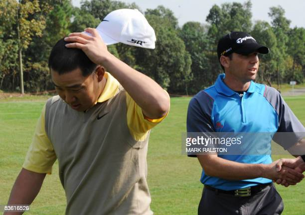 Anthony Kim of the US gestures after being disqualified from the event due to a club violation in the third round of the HSBC Champions golf...