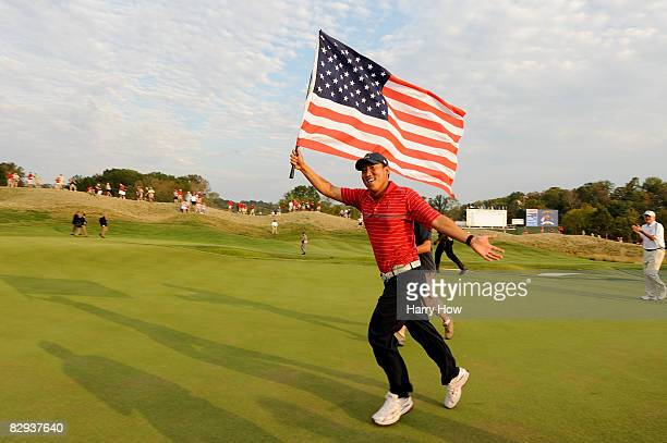 Anthony Kim of the USA celebrates with an American flag after the USA 16 1/2 - 11 1/2 victory on the final day of the 2008 Ryder Cup at Valhalla Golf...
