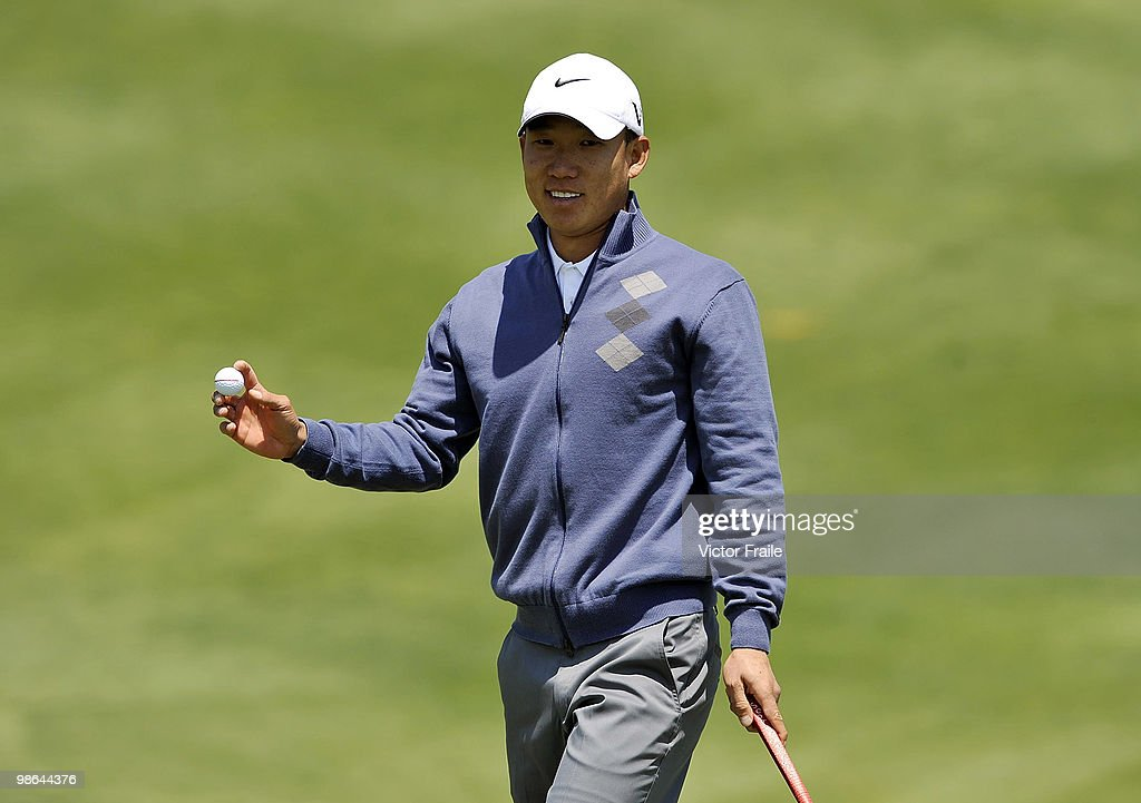 Anthony Kim of USA acknowledges to the crow on the 12th green during the Round Two of the Ballantine's Championship at Pinx Golf Club on April 24, 2010 in Jeju island, South Korea.