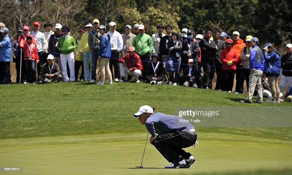 Anthony Kim of USA lines up a putt on the 8th green during the Round Two of the Ballantine's Championship at Pinx Golf Club on April 24, 2010 in Jeju island, South Korea.