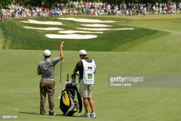 Anthony Kim pulls out a club on the 5th hole during the final round of the Wachovia Championship at Quail Hollow Country Club on May 4 2008 in...