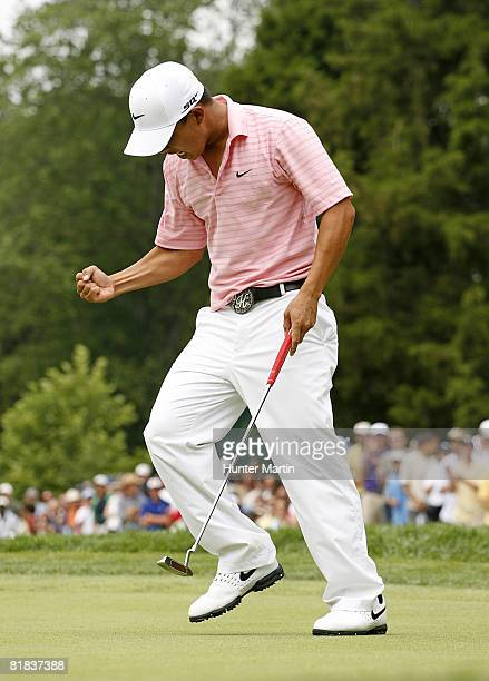 Anthony Kim reacts after making his birdie putt on the 16th hole during the final round of the AT&T National at Congressional Country Club on July 6,...