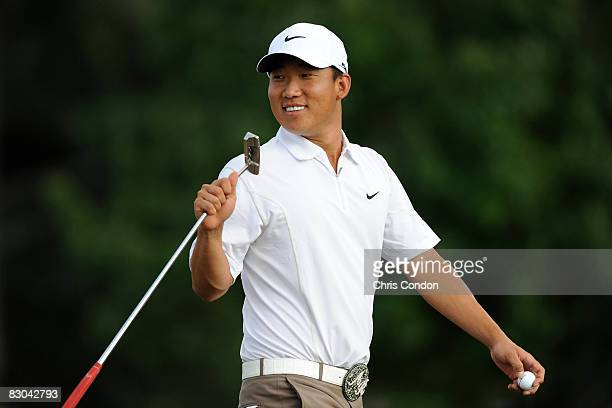 Anthony Kim walks off the 13th green during the final round of THE TOUR Championship presented by CocaCola at East Lake Golf Club on September 28...