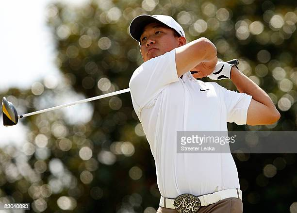 Anthony Kim watches his tee shot on the 5th hole during the final round of THE TOUR Championship presented by CocaCola at East Lake Golf Club on...