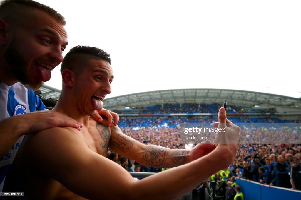 Anthony Knockaert and Jiri Skalak of Brighton & Hove Albion celebrate with team-mates in the stands after victory in the Sky Bet Championship match between Brighton & Hove Albion and Wigan Athletic at Amex Stadium on April 17, 2017 in Brighton, England.