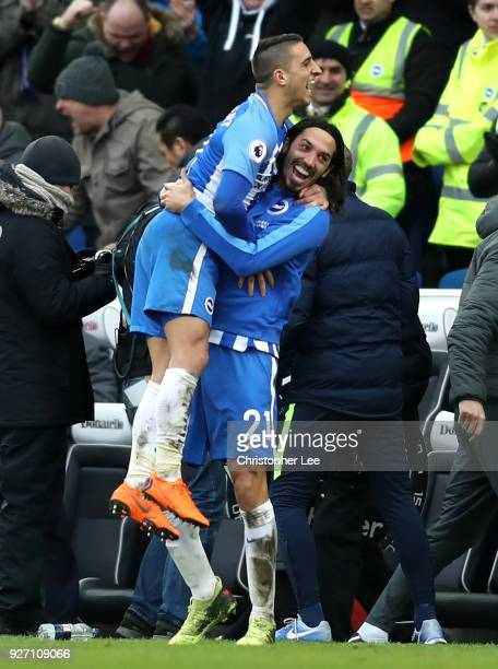 Anthony Knockaert and Matias Ezequiel Schelotto of Brighton and Hove Albion celebrate following the Premier League match between Brighton and Hove...