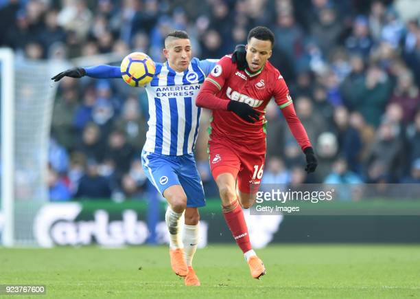 Anthony Knockaert of Brighton and Hove Albion and Martin Olsson of Swansea City battle for the ball during the Premier League match between Brighton...